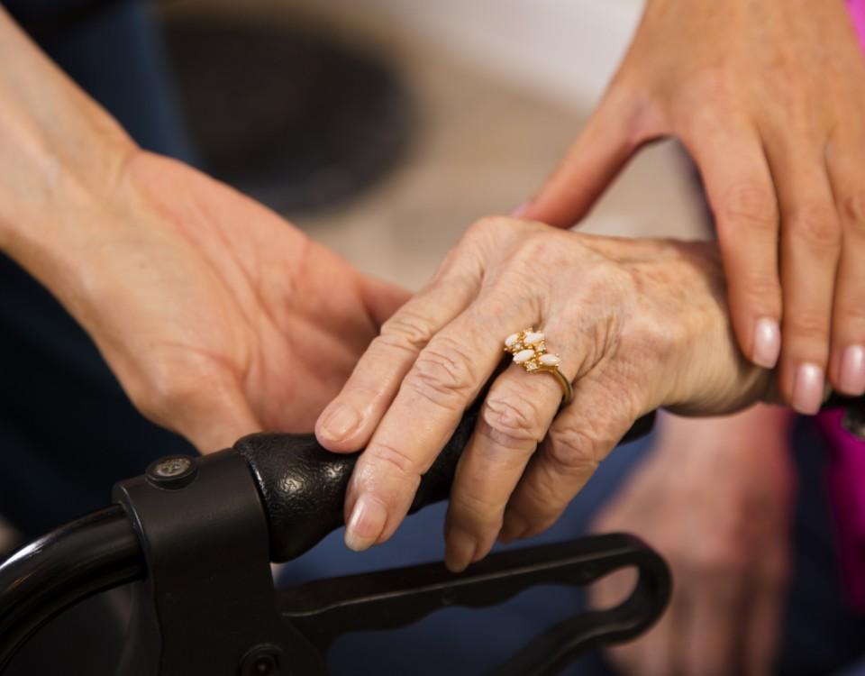 Home-healthcare-nurse-helps-senior-woman-use-walker-000069597473_Medium